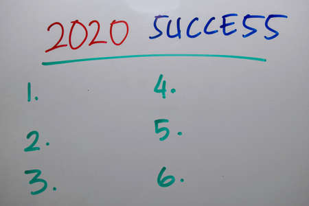 2020 Success with number in sequence write on white board background Imagens
