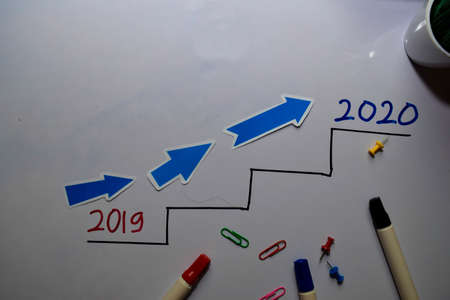 2019 to 2020 on Top write on white board background Imagens