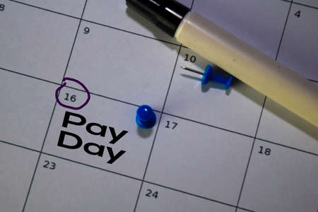 Pay Day write on calendar. Date 16. Reminder or Schedule Concepts