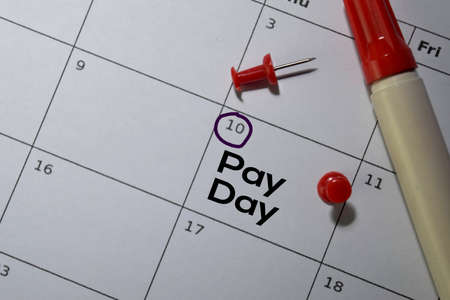 Pay Day write on calendar. Date 10. Reminder or Schedule Concepts