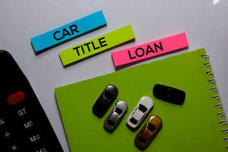 Car Title Loan write on sticky note and Toy Car. white background