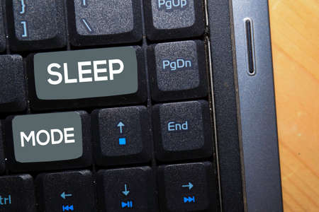 Sleep Mode write on keyboard isolated on laptop background