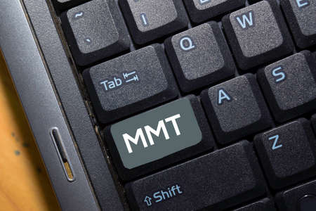 MMT write on keyboard isolated on laptop background Stockfoto