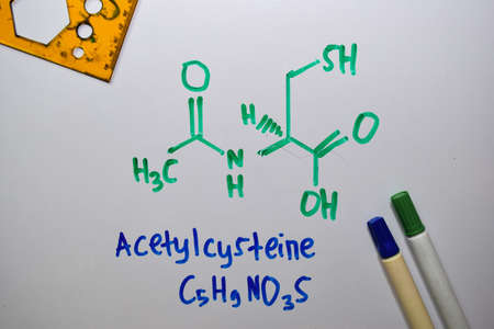 Acetylcysteine write on the white board. Structural chemical formula. Education concept