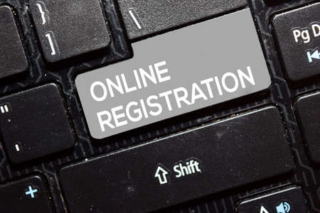 Online Registration write on keyboard isolated on laptop background