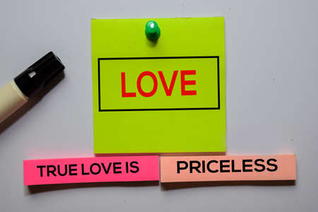 Love. True Love Is Priceless text on sticky notes isolated on office desk Stockfoto