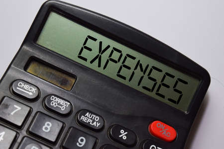 Expenses write on the calculator with white board background