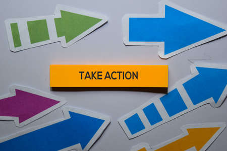 Take Action text on sticky notes isolated on office desk Stockfoto