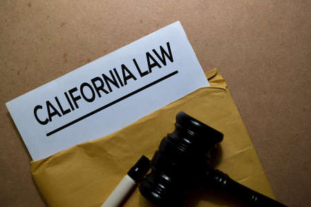 California Law in brown envelope and judges gavel. Justice and Law Concept