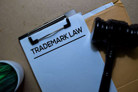 Trademark Law above brown envelope and judges gavel. Justice and Law Concept