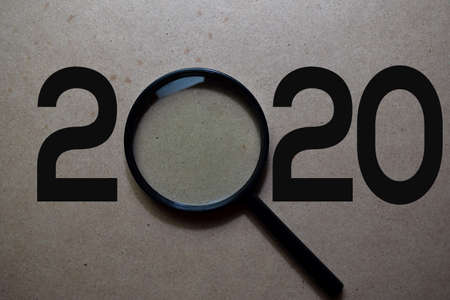 2020 Happy New Year with Magnifying glass concept.