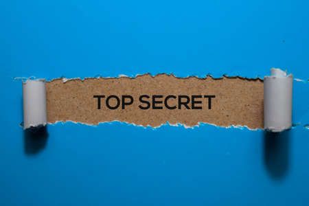 Top Secret write on blue torn paper