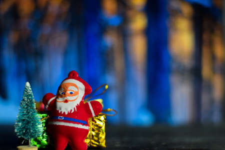 Close up decoration santa claus dolls and christmas gifts isolated on bokeh background
