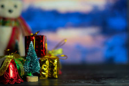 Close up decoration snowman and christmas tree isolated on bokeh background. selective focus on christmas tree