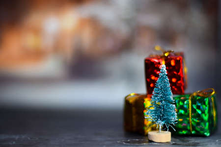 Close up decoration christmas tree and christmas gifts isolated on bokeh background