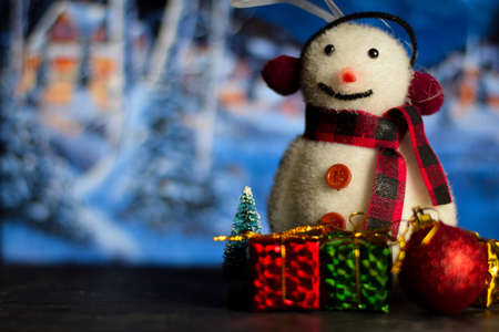 Close up decoration snowman and christmas tree isolated on bokeh background