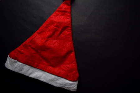 Santa Claus red hat isolated on black background