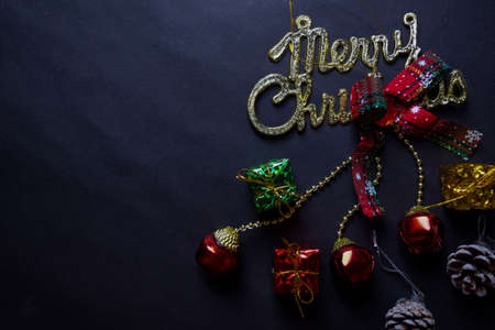 merry christmas text and Decorative Christmas isolated on black background