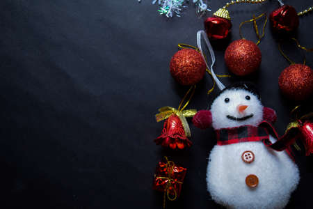 Decorative Christmas and snowman isolated on black background