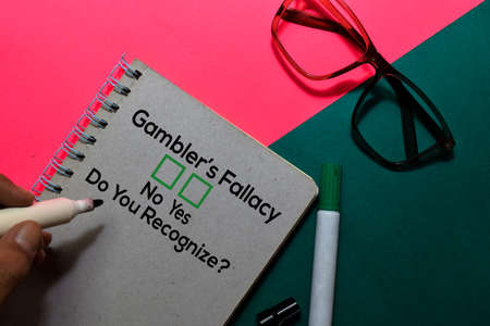 Gamblers Fallacy, Do You Rezognize? Yes or No. On office desk background Stock Photo