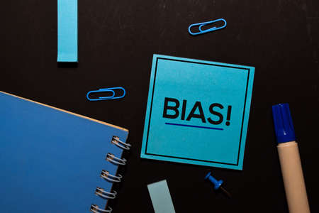 Bias! write on sticky notes isolated on office desk