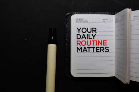 Your Daily Routine Matters. write on a book isolated on office desk