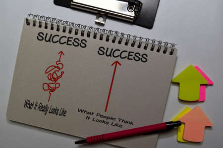 Success write on a book isolated on Office Desk Standard-Bild