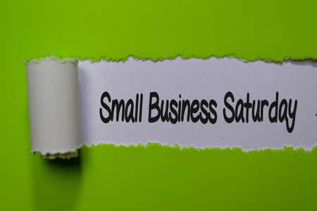 Small Business Saturday write on white and green torn paper