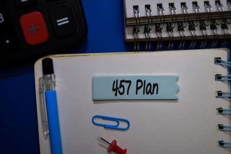 457 Plan write on sticky note isolated on Office Desk.