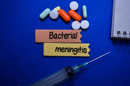 Bacterial Meningitis write on sticky note isolated on Office Desk. Healthcare or Medical Concept