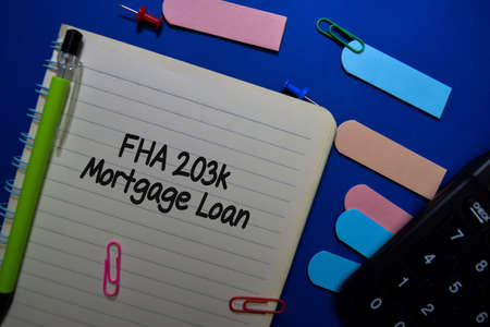 FHA 203k Mortgage Loan write on a book isolated on Office Desk