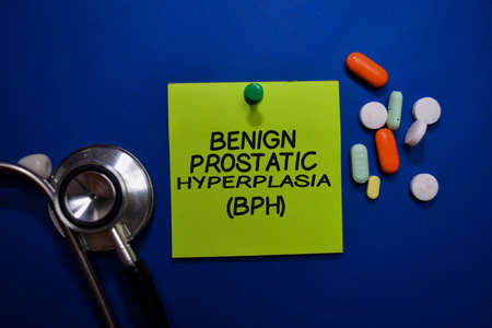 Benign Prostatic Hyperplasia (BPH) write on sticky note isolated on Office Desk. Healthcare or Medical Concept Stockfoto
