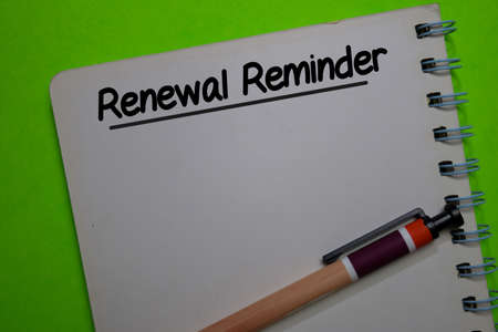 Renewal Reminder write on a book isolated on Office Desk Stockfoto