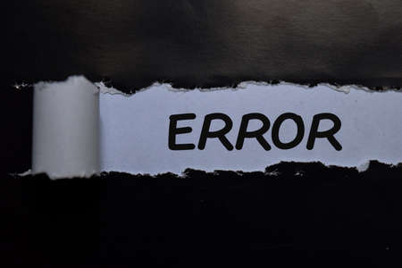 Error write on black and white torn paper
