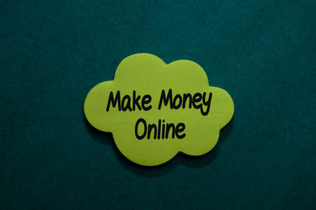 Make Money Online write on sticky note isolated on Office Desk.