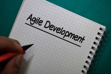 Agile Development write on a book isolated on Office Desk Stockfoto