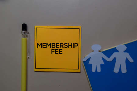 Membership Fee write on sticky note isolated on Office Desk.