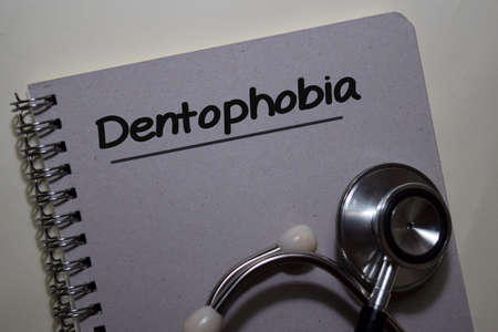 Dentophobia write on a book isolated on Office Desk. Medical or Healthcare concept
