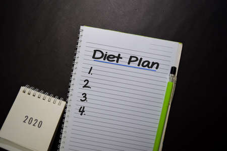Diet Plan write on a book isolated on black table. Stockfoto