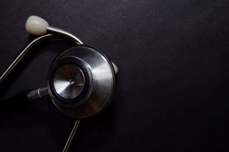 Close up Black Stethoscope isolated on black table