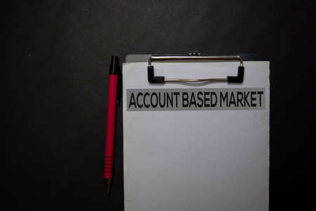 Account Based Market write on a paperwork isolated on black table.