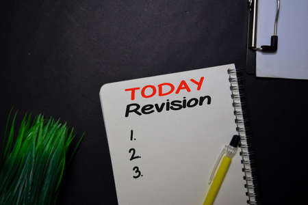 Today Revision write on a book isolated on black table. Stockfoto