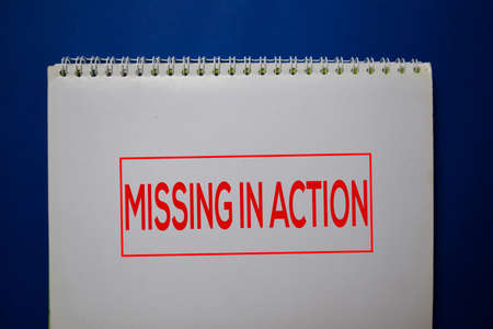 Missing Action write on a book isolated on blue background.