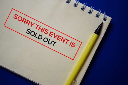 Sorry This Event Is Sold Out write on a book isolated on blue background.