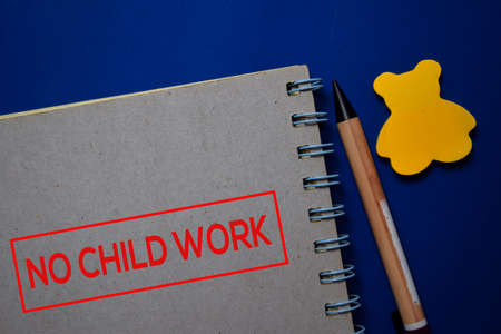 NO Child Work write on a book isolated on blue background. Stockfoto