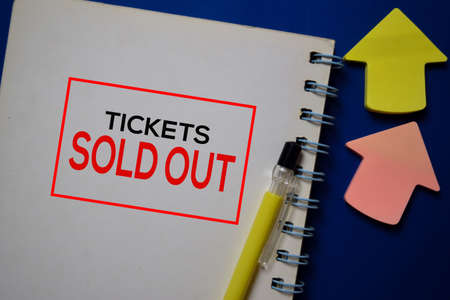 Tickets Sold Out write on a book isolated on blue background.