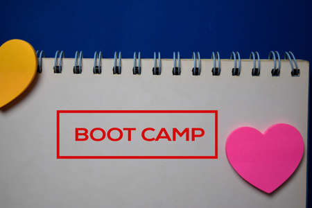 Boot Camp write on a book isolated on blue background.