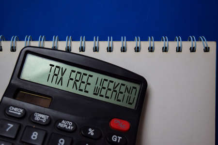 Tax Free Weekend write on the calculator on Office Desk.