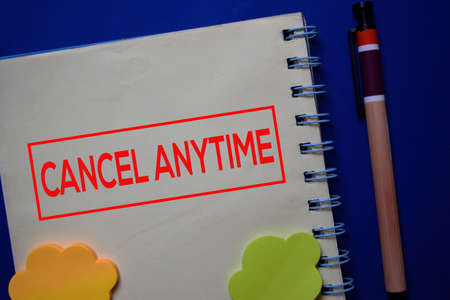 Cancel Anytime write on a book isolated on blue background.