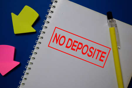 NO Deposite write on a book isolated on blue background.